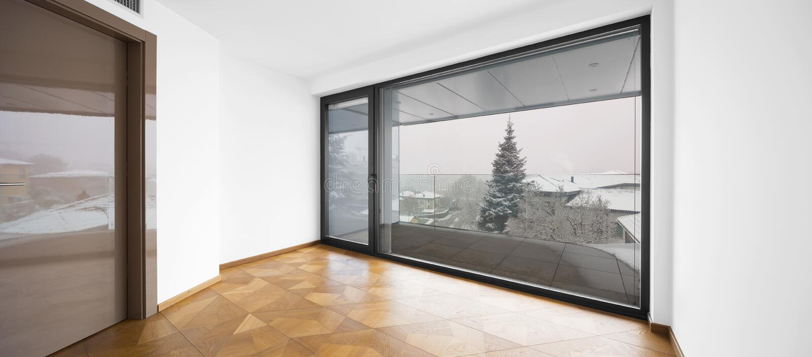 Empty room. It`s snowing outside. stock images