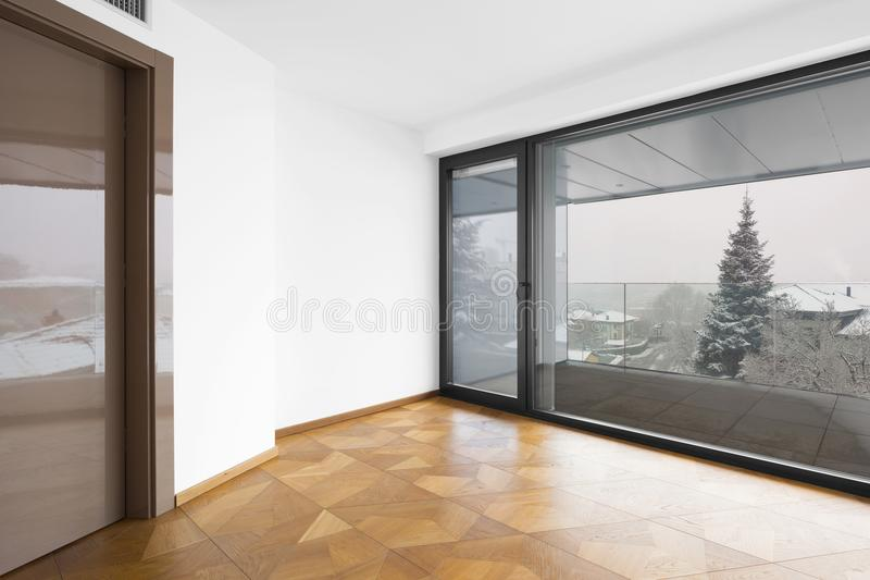 Empty room. It`s snowing outside. royalty free stock photo