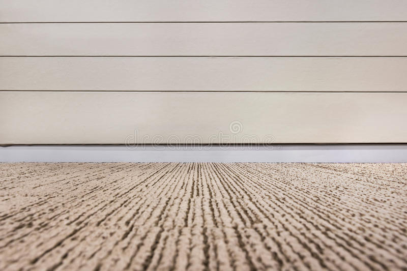 Empty room with wall and carpeting floor. royalty free stock photos