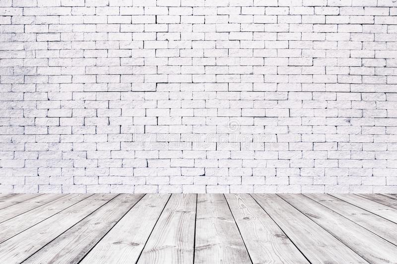 Room interior with white brick wall and wooden floor stock photography