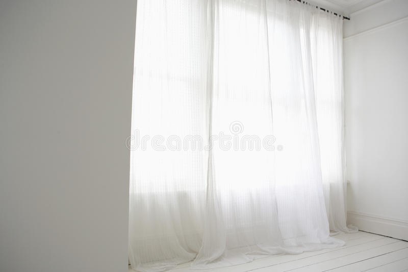 Empty Room with white curtain stock photo