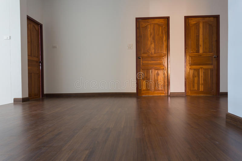 Empty room, white mortar wall background and wood laminate floor royalty free stock photos