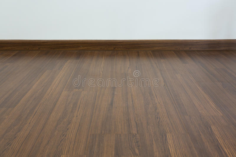 Empty room, white mortar wall background and wood laminate floor stock photos