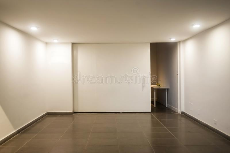 Empty room with white walls and no windows. Empty room with white walls stock images