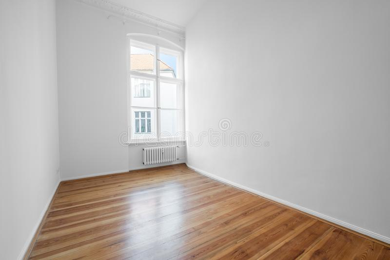 Empty room with white walls and wooden floor,. Empty room with white walls and wooden floor - real estate interior stock images