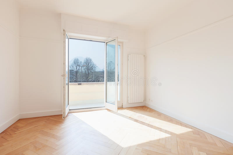 Empty room, windows are open royalty free stock image