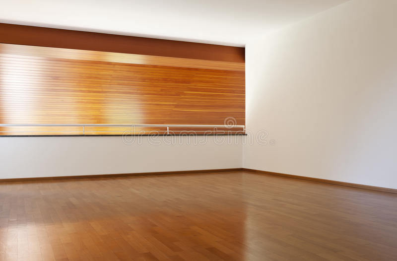 Empty room with wooden floor stock image