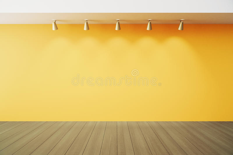Empty room with yellow wall with lapms and wood floor royalty free stock photography