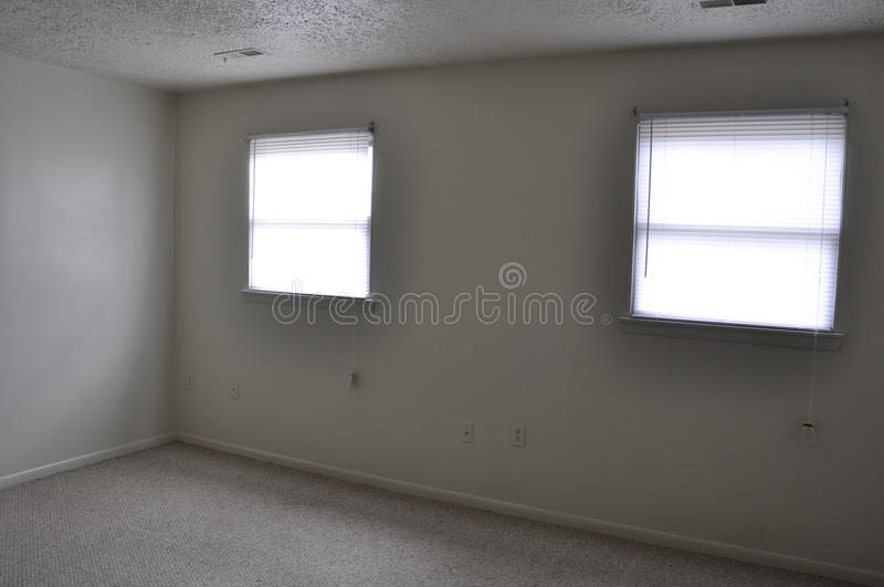 Empty rooom. Empty apartment room with windows, looking in to the corner royalty free stock photos