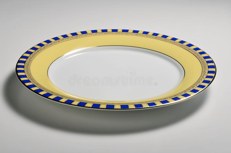 Empty round dish with decorated border royalty free stock photography