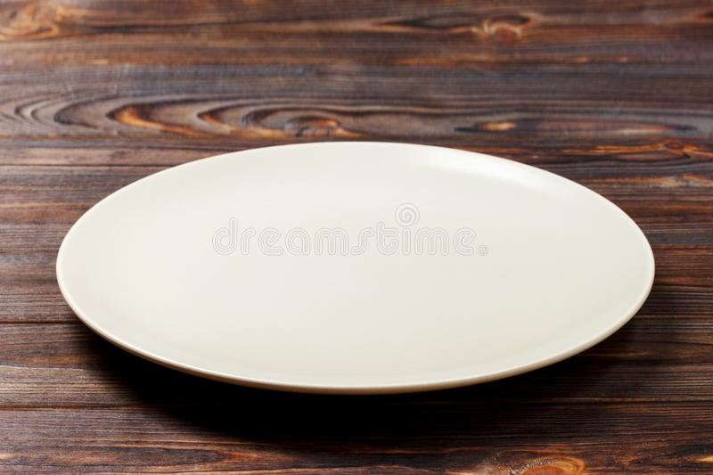 Empty round plate for food on wood bachground. Perspective view royalty free stock photos