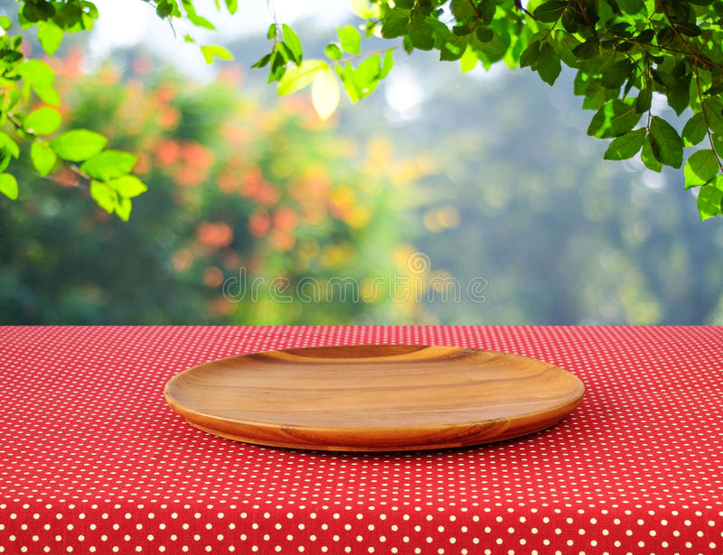 Download Empty Round Wooden Tray On Red Polka Dot Tablecloth Over Blur Tr Stock Image - Image of cover, outdoor: 54867395