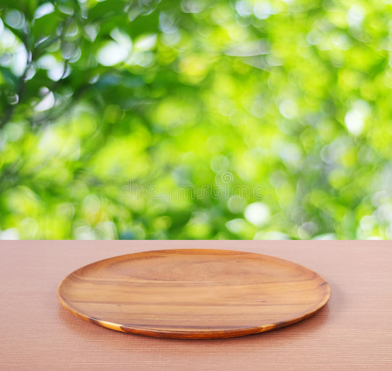 Download Empty Round Wooden Tray On Table Over Blur Tree Background Stock Photo - Image of backdrop, page: 54920896