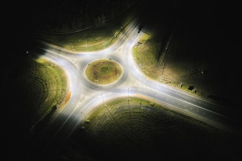 Empty roundabout at night royalty free stock photos