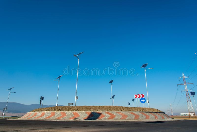 Empty roundabout , photovoltaic panels for illumination royalty free stock images