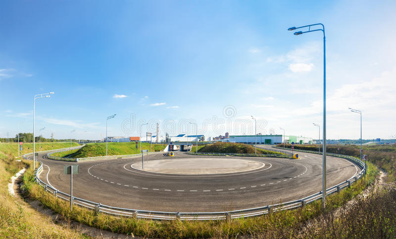 Empty roundabout in suburb stock photos