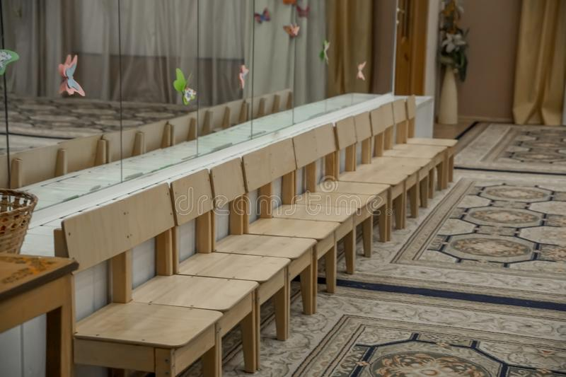 Empty row of wood children chairs in music room before celebration in music-hall waiting party royalty free stock photography