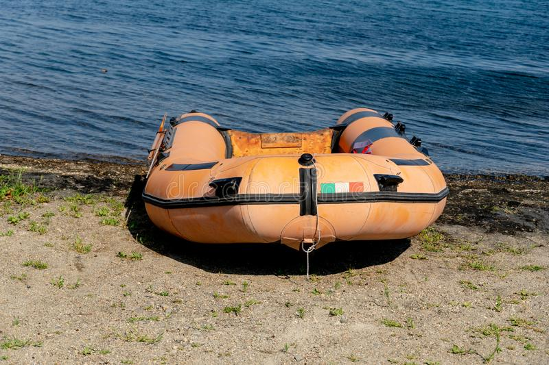 Rubber dinghy. Empty rubber dinghy on the beach royalty free stock images