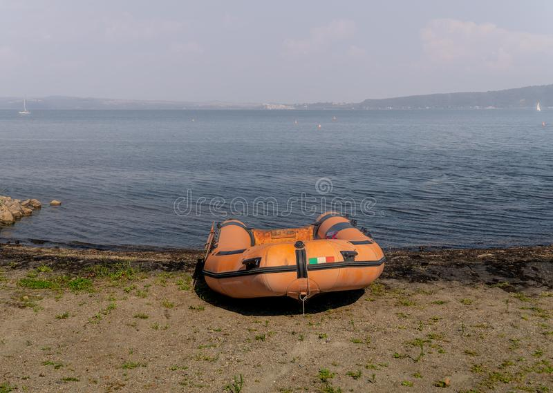 Rubber dinghy. Empty rubber dinghy on the beach royalty free stock image