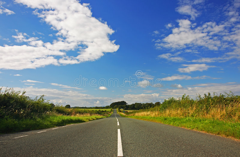 Empty rural road. Empty road in the English countryside royalty free stock image
