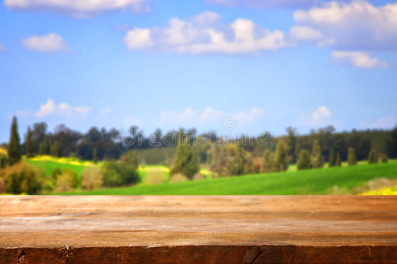 Empty rustic table in front of countryside stock photos