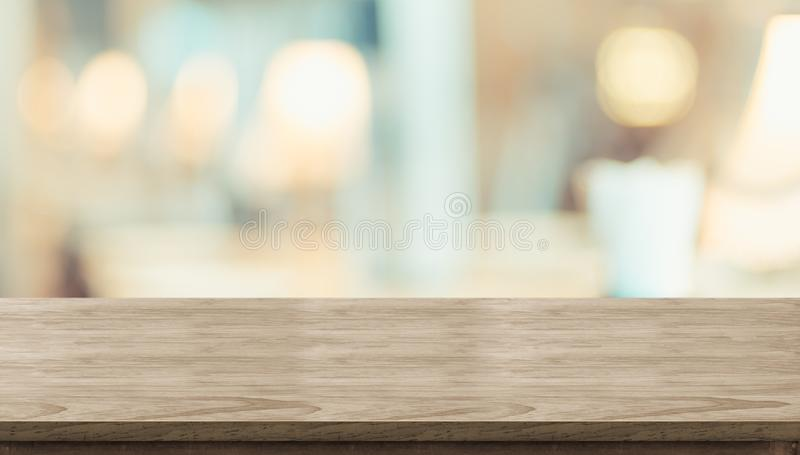 Empty rustic wood table and blurred soft light table in restaurant with bokeh background. product display. Template.Business presentation stock photo