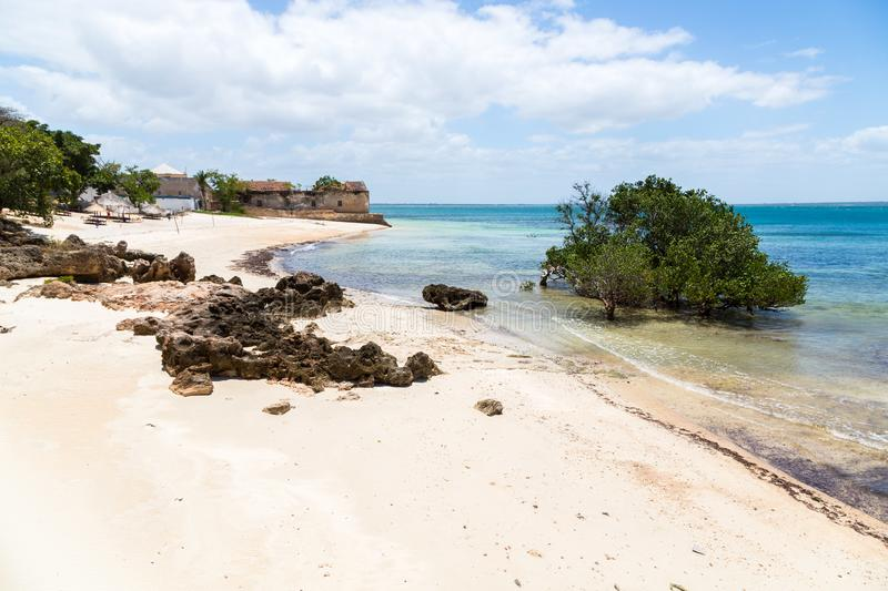 Empty sandy beach of Mozambique island, mangroves and remains of a colonial house, Indian ocean. Nampula. Portuguese East Africa. Empty sand beach of Mozambique royalty free stock photo