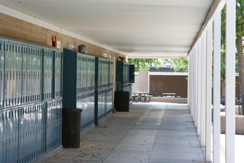 Empty school breezeway. Lined with lockers stock photo