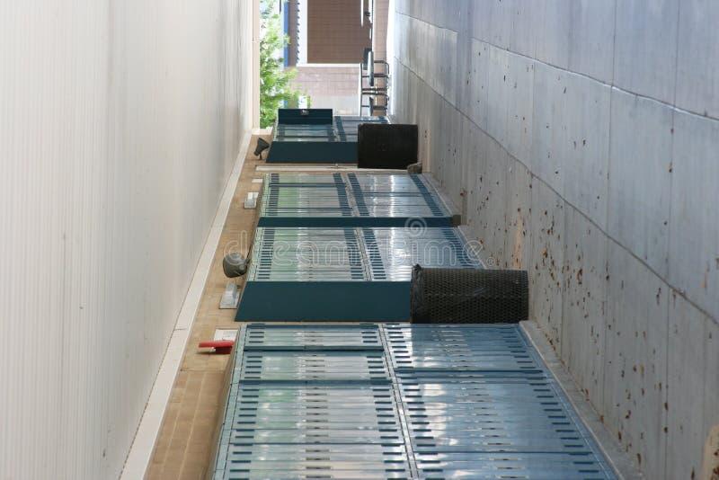 Empty school breezeway. Lined with lockers stock photography