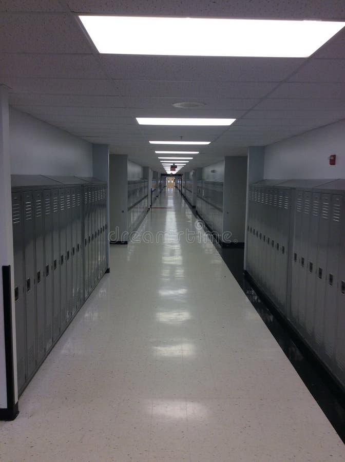 Empty school hallway. Empty high school hallway with grey lockers stock photo