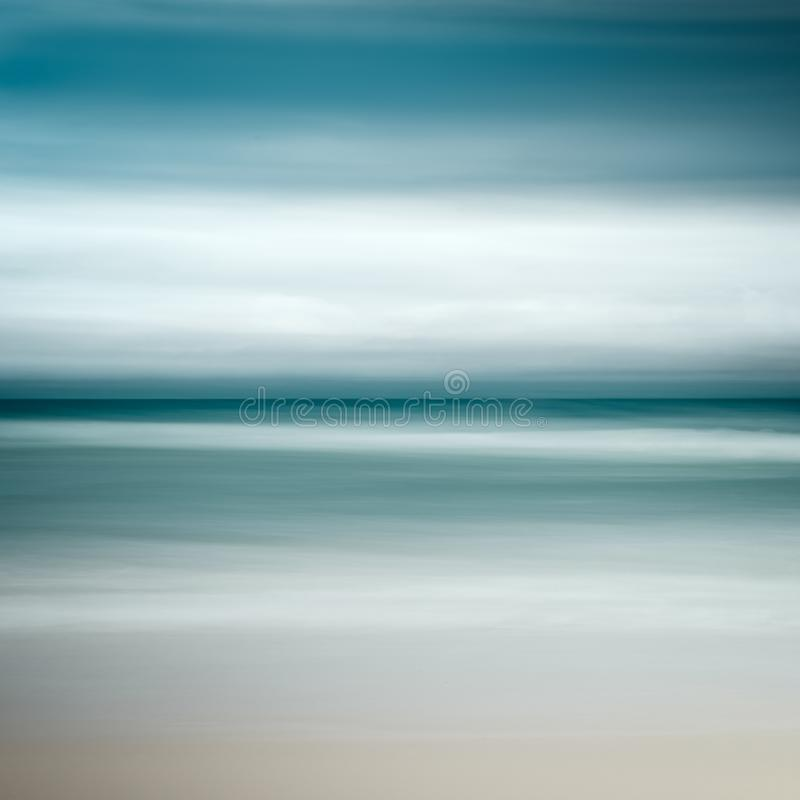 Empty sea and beach background with copy space, Long exposure, blur motion blue abstract vintage tinted gradient background.  stock image