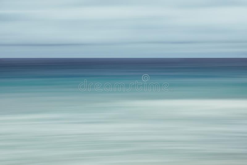 Empty sea and beach background with copy space, Long exposure, blur motion blue abstract vintage tinted gradient background.  royalty free stock images