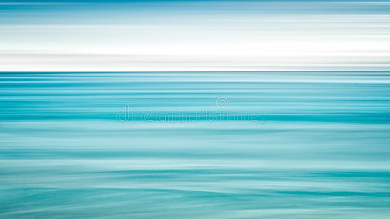 Empty sea and beach background with copy space, Long exposure, blur motion blue abstract vintage tinted gradient background.  royalty free stock photography