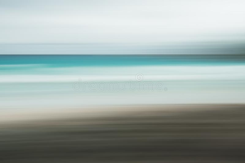 Empty sea and beach background with copy space, Long exposure, blur motion blue abstract vintage tinted gradient background.  royalty free stock photos