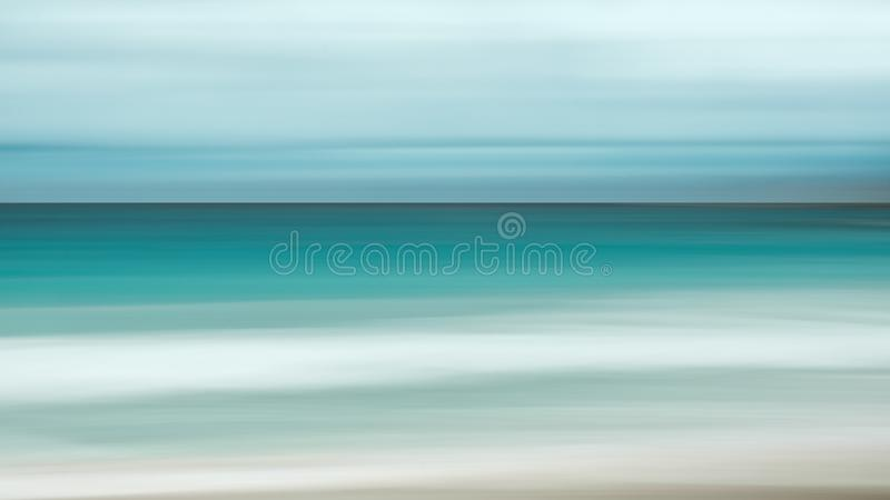 Empty sea and beach background with copy space, Long exposure, blur motion blue abstract vintage tinted gradient background.  royalty free stock photo