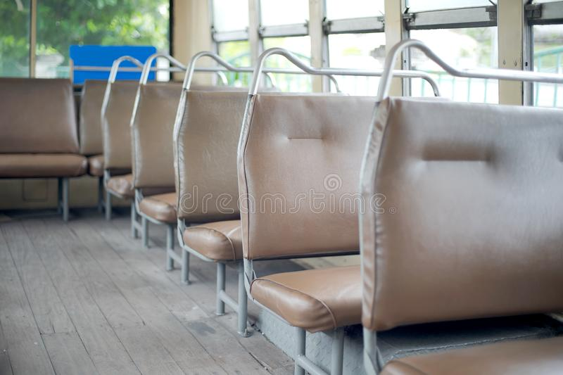 Empty Seat on a Thailand red public bus service in Bangkok.  stock photos