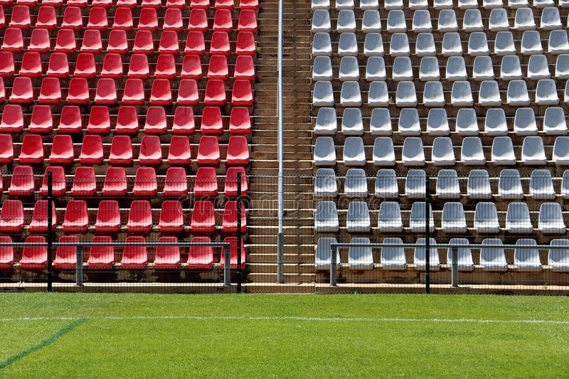 Empty seating at the Rand Stadium, Soweto, South Africa. Empty red and grey seating at the Rand soccer football Stadium, Soweto, South Africa, for opposition stock photos
