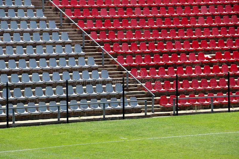 Empty seating at the Rand Stadium, Soweto, South Africa. Empty red and grey seating at the Rand soccer football Stadium, Soweto, South Africa, for opposition stock image