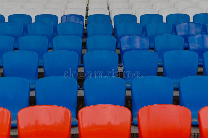Empty seats for spectators at the stadium stock photo