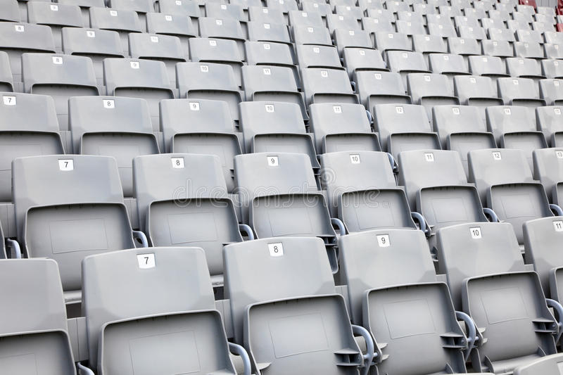 Empty seats in a stadium. Empty plastic seats in a sports stadium stock photography