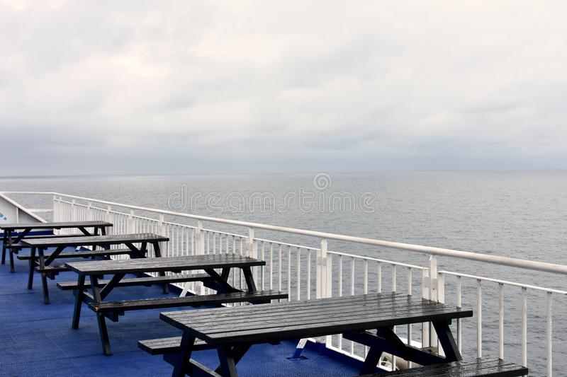 Seats and tables on a ferry boat stock photo