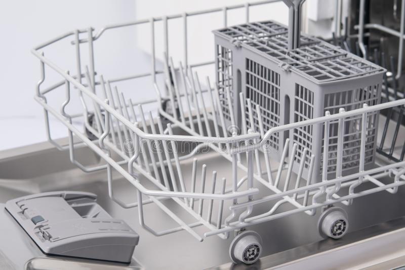 Empty section of the dishwasher, dry after work stock photos