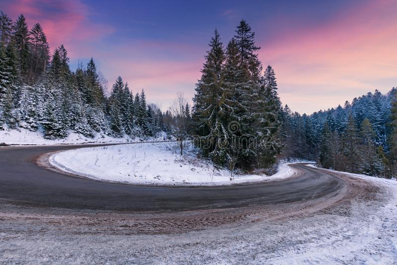 Empty serpentine road in mountains stock image