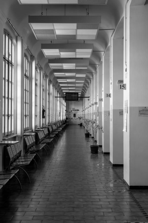 Empty service. Turin, Italy - March 23, 2019 : Empty corridor with a row of counters of the Turin registry office during weekend royalty free stock photos