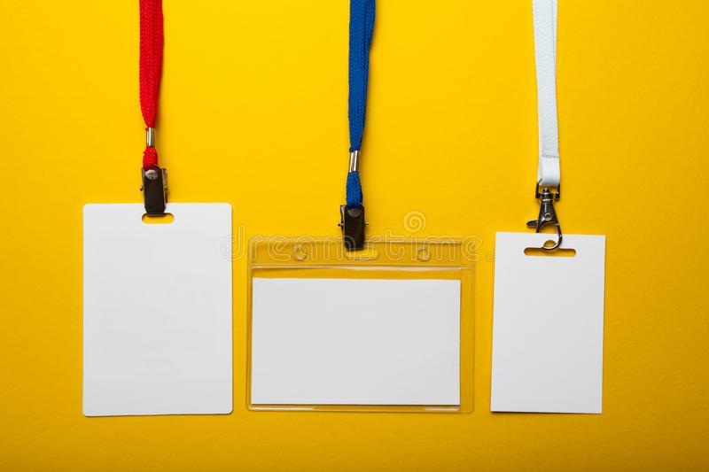 Empty set of ID badge isolated on yellow background.  stock images