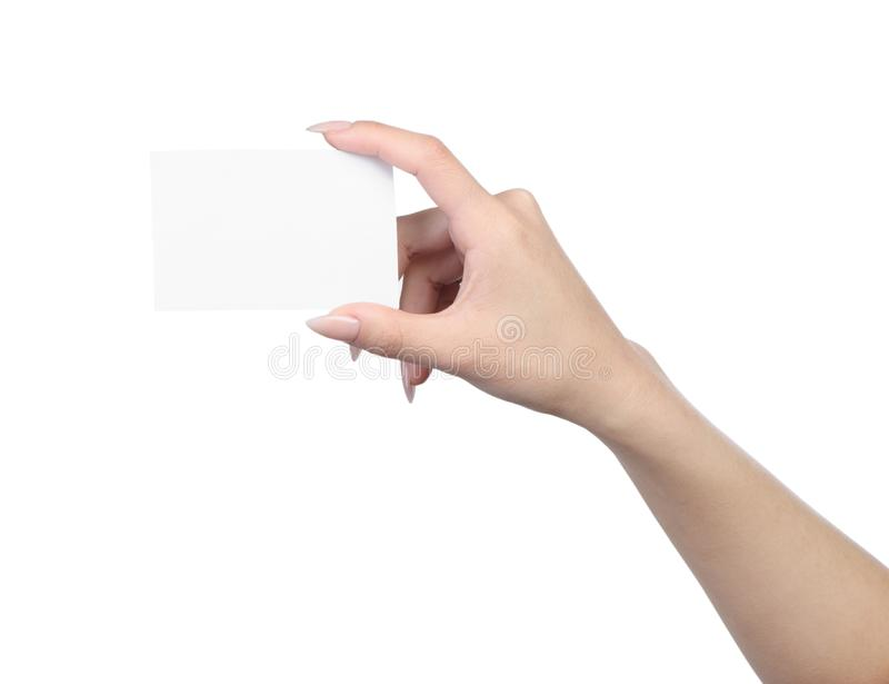 Empty sheet of paper in female hand. With manicure isolated on white royalty free stock images