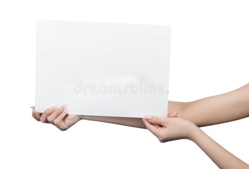 Empty sheet of paper in female hands. With manicure isolated on white royalty free stock image