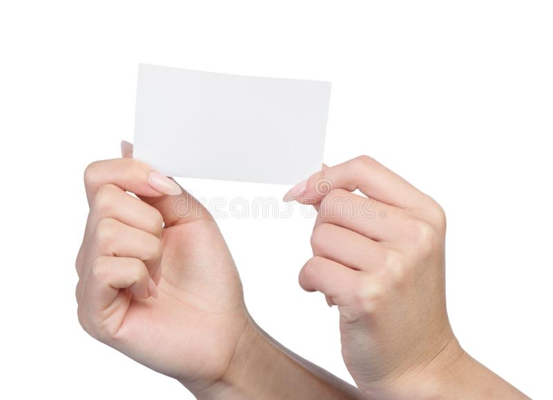 Empty sheet of paper in female hands. With manicure isolated on white stock photo
