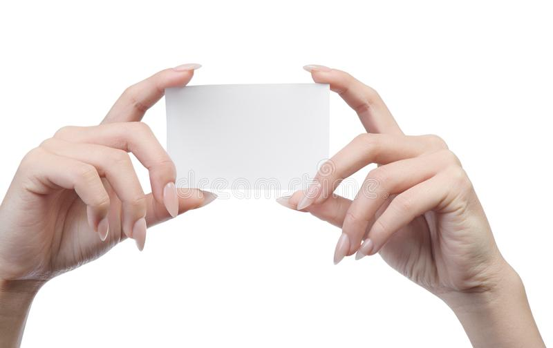 Empty sheet of paper in female hands. With manicure isolated on white royalty free stock photos