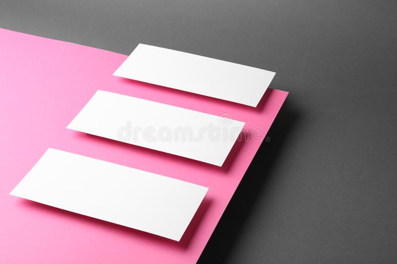 Empty sheets on color background. Mockup for design stock photo